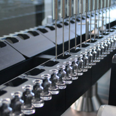 Vial processing machines