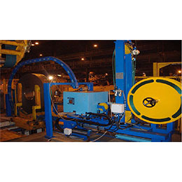 AUTOMATIC CIRCUMFERENCIAL STRAPPING MACHINE FOR COILS