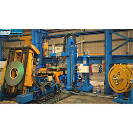AUTOMATIC RADIAL STRAPPING MACHINE FOR SLIT COILS