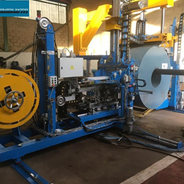 AUTOMATIC STRAPPING MACHINE FOR THE OD STRAPPING OF SLIT COILS WITH INTRODUCTION OF CARDBOARD PROTECTORS