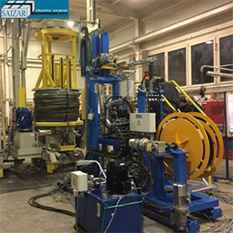 AUTOMATIC STRAPPING MACHINE FOR THE RADIAL STRAPPING OF WIRE ROD COILS WITH INTRODUCTION OF O-RINGS