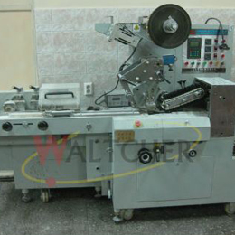 Cuting and wrapping machine